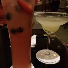 Photo taken at The Library Bar & Cigar Lounge at Four Seasons Hotel Doha by Hanny W. on 1/31/2014