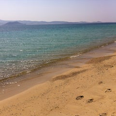 Photo taken at Παραλία Πλάκας (Plaka Beach) by Katerina O. on 5/4/2013