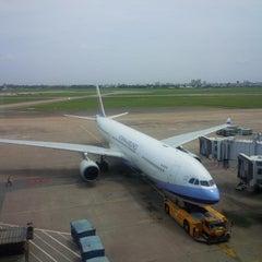 Photo taken at Tan Son Nhat International Airport (SGN) Sân Bay Quốc Tế Tân Sơn Nhất by Hai L. on 7/18/2013