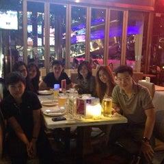 Photo taken at People's Cafe by Suritsada on 9/19/2014