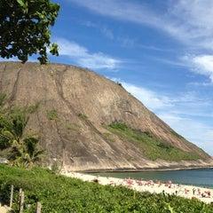 Photo taken at Praia de Itacoatiara by Raphael P. on 2/18/2013