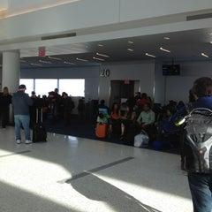 Photo taken at Gate 20 by Alan C. on 3/17/2013