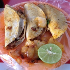 Photo taken at Tacos y Tortas Ahogadas Novilleros by Miguel G. on 12/2/2012