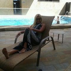 Photo taken at Malibu Palace Hotel by Aline B. on 2/13/2013