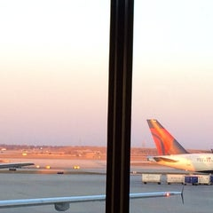 Photo taken at Gate F8 by Mollie T. on 4/5/2014