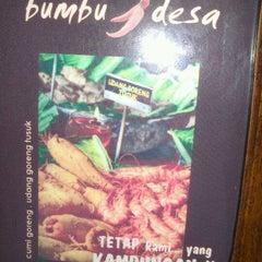Photo taken at Bumbu Desa by Caca C. on 10/28/2012