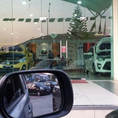 Photo taken at Perodua Sales & Service Center by 🎀  funna f. on 10/7/2014
