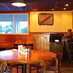 Photo taken at Outback Steakhouse by Ken S. on 12/14/2013