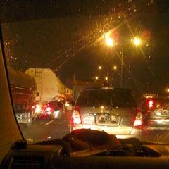 Photo taken at Jalan Tol Lingkar Luar Jakarta Seksi W1 (JORR W1) by Vendy S. on 10/12/2013