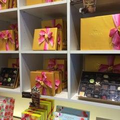 Photo taken at Godiva Chocolatier by Dan W. on 7/22/2014