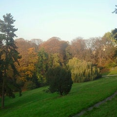 Photo taken at Parc des Buttes-Chaumont by Kelsey U. on 10/25/2012