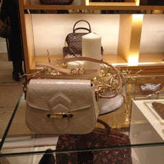 Photo taken at Louis Vuitton by Елена К. on 12/13/2012
