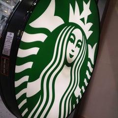 Photo taken at Starbucks by Ekaterina S. on 7/9/2013