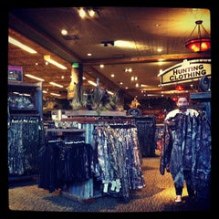 Photo taken at Bass Pro Shops by Erin on 6/10/2013