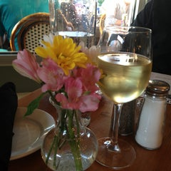 Photo taken at Petite Chou Bistro and Champagne Bar by Rebecca L. on 4/30/2013