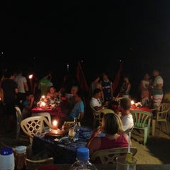 Photo taken at Seaslug's Beach Bar And Resto by Ben C. on 4/19/2013