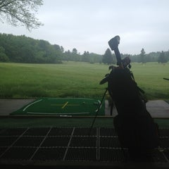 Photo taken at Fenway Golf by Caitlin T. on 5/23/2013