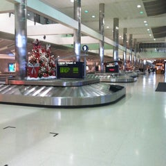 Photo taken at Baggage Claim by Angela on 11/29/2012