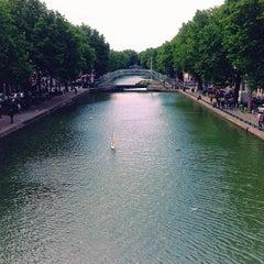 Photo taken at Canal Saint-Martin by Alex H. on 6/23/2013