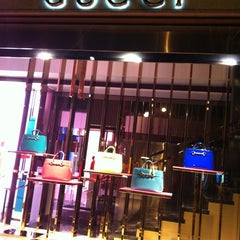 Photo taken at Gucci by Linda on 3/26/2013