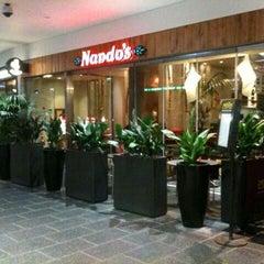 Photo taken at Nando's by Cem K. on 10/9/2013
