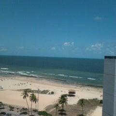 Photo taken at Praia do Pina by Carol P. on 2/16/2013