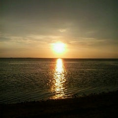 Photo taken at Pantai Ujung Genteng by Nugroho A. on 2/13/2013