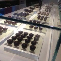 Photo taken at Fran's Chocolates by Sara on 2/16/2013