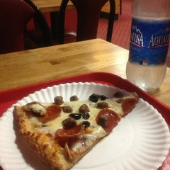 Photo taken at Mario's Gourmet Hand Tossed Pizza by Sara on 2/12/2013