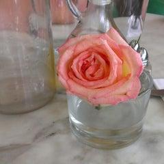 Photo taken at Rafaella Cafe by Perla H. on 7/5/2013