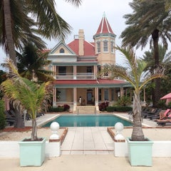 Photo taken at The Southernmost House by Patrick W. on 9/26/2014
