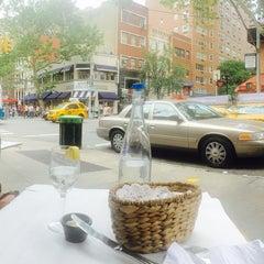 Photo taken at Mon Petit Café by Philip S. on 6/25/2015