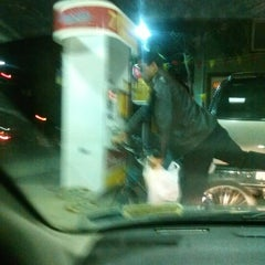 Photo taken at Shell by Chris C. on 10/6/2012