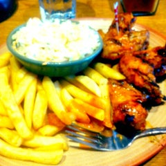 Photo taken at Nando's by Jamal A. on 6/30/2013