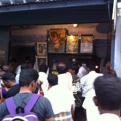 Photo taken at Iruttu Kadai (Halwa Store) by chelladurai p. on 6/8/2013