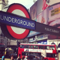 Photo taken at Piccadilly Circus by Toni T. on 4/25/2013