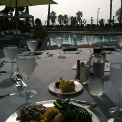 Photo taken at Shades Restaurant & Bar by Suzanne B. on 11/6/2012