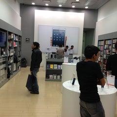 Photo taken at iShop by David M. on 3/28/2013