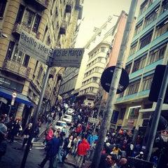 Photo taken at Rua 25 de Março by Vinícius G. on 7/26/2013
