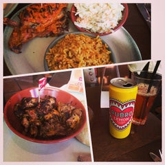 Photo taken at Nando's by Brian S. on 7/23/2014
