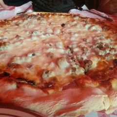 Photo taken at Filippi's Pizza Grotto by Henry V. on 9/25/2012