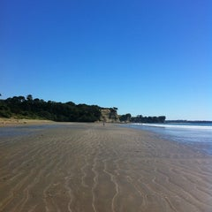 Photo taken at Long Bay Beach by Iain S. on 3/10/2013