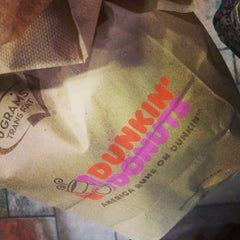 Photo taken at Dunkin' Donuts by Alachia Q. on 7/7/2014