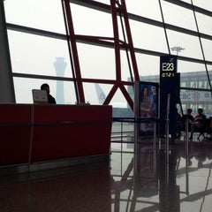 Photo taken at Gate E23 by Ming-i P. on 3/16/2013