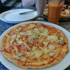 Photo taken at Піца Челентано / Celentano Pizza by Екатерина К. on 10/7/2012