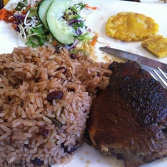 Photo taken at Guilligans Caribbean Food by Angie C. on 1/18/2013