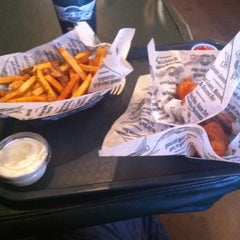 Photo taken at Wingstop by Mark E. on 12/29/2013