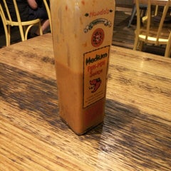 Photo taken at Nando's by Tom S. on 12/29/2015