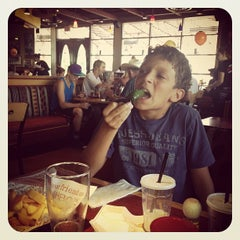 Photo taken at Red Robin Gourmet Burgers by Stacey L. on 8/11/2013