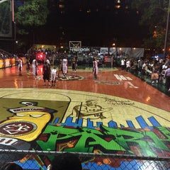 Photo taken at Rucker Park Basketball Courts by Max B. on 8/8/2014